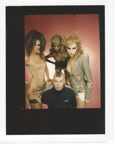 "Lee McQueen with models, backstage at his A/W 1997 show ""It's A Jungle Out There"""