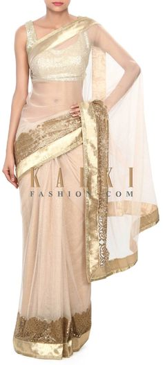 Buy Online from the link below. We ship worldwide (Free Shipping over US$100) Price- $219 Click Anywhere to Tag http://www.kalkifashion.com/gold-saree-adorn-in-moti-border-only-on-kalki.html