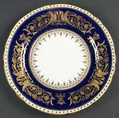 """""""Seville"""" china pattern in royal blue with ornate Baroque gold trim & white center from Aynsley."""