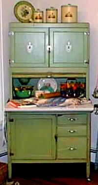 "Founded in 1898 in Indiana, The Hoosier Manufacturing Company came up with the clever idea of taking a standard cupboard and turning it into an efficient and compact baking center. These free standing work stations had every ""modern"" convenience such as a tilt-out flour bin that could hold 50 pounds of flour with a built-in sifter in its base along with a sugar bin and spice rack"