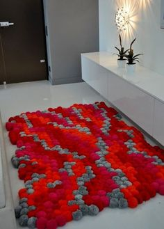 Fantastic pom pom rug...this must have taken awhile to make!