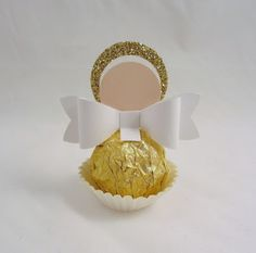 Look at the sweet little angel I made out of a Ferrero Rocher.  I used a couple of circle punches and the bow builder punch to create it....