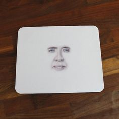 Increase productivity with simple mouse mat. | 22 Inspired Products To Let The World Know You're A Nicolas Cage Fan