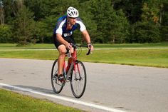 Triathlete Cycling on a Road Bike during competition