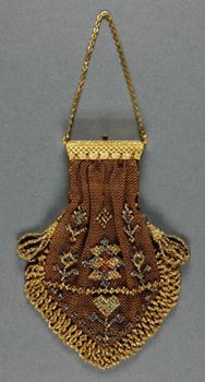 Woman's Purse, made in United States, mid- to late- 19th century.     Silk net, metallic beading, metal clasp and chain.
