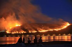 24 hours: Ciovo, Croatia: People watch the hillsides ablaze with wildfires