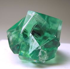 A facet grade twinned crystal of Fluorite with a beautiful green color.  It is lustrous overall and apart from the bottom contact is in good...
