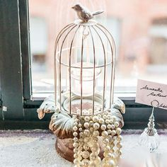 Add a bit of sweet romance with this vintage inspired Metal Decorative Bird Cage with Suspended Tea Light Holders, perfect for your venue's table centerpieces.