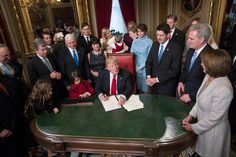 President Donald Trump is joined by the Congressional leadership and his family as he formally signs his cabinet nominations into law, in the President's Room of the Senate, at the Capitol in Washington, D.C., U.S., January 20, 2017. --