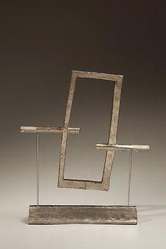 YAMADA HIKARU Open four-part rectangular sculpture, ca. 1995  Silver glazed stoneware with steel pins   12 1/4 x 12 1/2 x 3 3/4 inches  Inv# 7391  POR Image