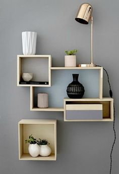 A copper desk lamp acting as an accent light on a shelf arrangement