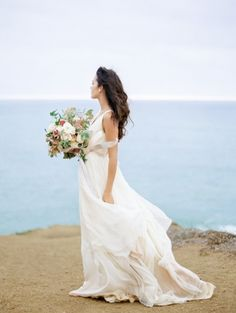Stunning cliffside inspiration: http://www.stylemepretty.com/california-weddings/2015/03/16/romantic-coastal-wedding-inspiration/ | Photography: Coco Tran - http://www.cocotran.com/