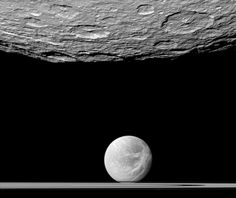 NASA's Cassini spacecraft looks past the cratered south polar area of Saturn's moon Rhea to spy the moon Dione and the planet's rings in the distance. Dione's 'wispy' terrain can be seen on the trailing hemisphere of that moon. Nasa Solar System, Solar System Exploration, Space Exploration, Hubble Pictures, Hubble Images, Sistema Solar, Saturns Moons, Science, Spacecraft