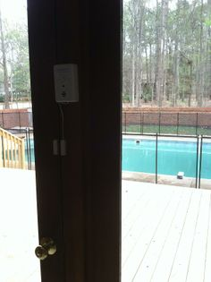3 layers of protection in 1 photo.  1 door alarm, 1 pool fence and 1 pool alarm.