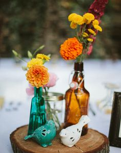 Cute centerpieces with the sliced log as a base.