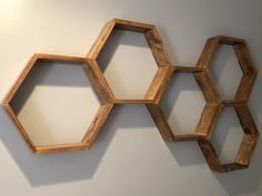 Cheap and easy DIY hexagon wall hanging shelves for any room in your house! Wall Hanging Shelves, Wall Shelf Decor, Bar Shelves, Wooden Shelves, Floating Shelves, Tv Shelf, Hexagon Wall Shelf, Wooden Crafts, Wooden Projects