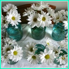 Decorate your table with mason jars. Just add a little water and some daisies. Simple and beautiful!!!