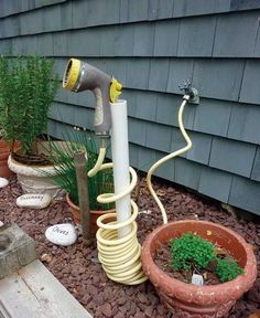 1. pvc pipe for coiled hose storage. Top 20 Low-Cost DIY Gardening Projects Made With PVC Pipes