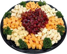 """""""We tend to mindlessly eat from these and the calories add up significantly,"""" says Middleberg. """"If you really want it, put four small pieces on a plate and eat them slowly. Deli Platters, Cheese Platters, Food Platters, Party Platters, Cheese Tray Display, Cheese Party Trays, Cheese And Cracker Tray, Meat And Cheese Tray, Cheese Cubes"""
