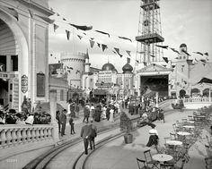 """New York circa 1905. """"Dreamland Park at Coney Island."""" Among the amusements to be sampled: An observation tower, the Bostock trained animal show, a Baltimore Fire cyclorama, the General Bumps ride, a miniature railway, Will Conklin's Illusions, the Temple of Mirth and Hooligan's Dream. 8x10 inch dry plate glass negative, Detroit Publishing Company. View full size."""