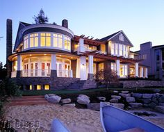 Situated along the north shore of Mercer Island, this traditional Shingle Style design recalls the feel and grandeur of late 19th Century East Coast seaside homes. Located on a wide waterfront lot with an outcropping into the lake, the house is securely anchored to the ground by a stone base.