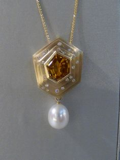 Custom handcrafted citrine, diamond and pearl pendant.