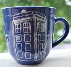 """Buy a mug from a thrift or dollar store, a ceramic marker from Michael's, and decorate!"" (TARDIS mug for my love of Doctor Who =P)"