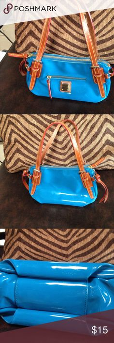 Dooney & Bourke small satchel Blue patent leather satchel with brown leather trim by Dooney & Bourke. Carried but in great condition. The last picture shows some wear but is hardly noticeable. Dooney & Bourke Bags Satchels