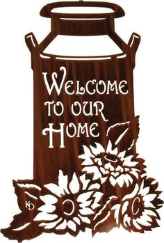 "Dimensions: 22""H x 14""W Color: Brown Description: The words ""welcome to our home"" adorn a metal wall sculpture of an old-fashioned milk can. This metal wall decoration is accentuated by flowers to add even more appeal Material: American Steel Finish: Glossy smooth finish Weight: 4lbs. Mounting Brackets: Included mounted hooks on back which cause the artwork to float off the wall by 0.5 inches Usage: Indoor / Outdoor (weathers naturally with time) Ships in: Ships in 2 - 6 business days…"