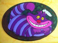 """Gato de Cheshire. El cartel de señal está en blanco y se puede poner el nombre de un peque o algo como """"felicidad"""" etc Esta hecho en un lienzo ovalado con acrílico, relieves y un gato locuelo! 45€ Https://www.facebook.com/cuadritos.decolores.7"""