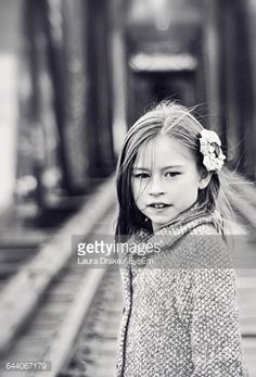 Stock Photo : Girl Wearing Flower In Hair While Standing On Railroad Tracks