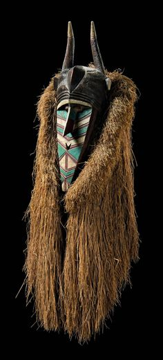 """Africa   Anthropomorphic mask """"banda"""" or """"kumbaruba"""" from the Baga people of Guinea   Wood; white, turquoise and dark red paint.  Framed with a compact grass collar   ca. 1914."""