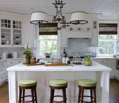 See how a pop of color can change the white palette to put your personal touch on your kitchen!