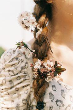 spontaneous flowers decorating messy braids