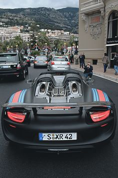 Porsche 918 Spyder! Hybrid motors, one electric motor for each wheel, then one gas engine that kicks in after a certain speed. Great car.