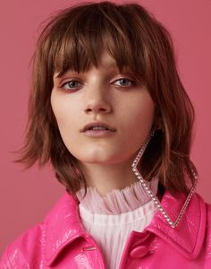 Photographed by Jason Kim, Peyton Knight models pink looks for the fashion editorial