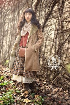 I don't like the baggy look, but the layers and colors, ohyes. And if that scarf was over the head instead of around the neck. Hee.