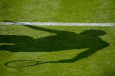 A shadow is shown on court during a match at the 2013 Championships Wimbledon