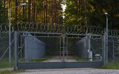 A barbed wire fence surrounding a military area is pictured in the forest in Stare Kiejkuty village in northeastern Poland, in this August 16, 2013 file photo. The CIA ran a secret jail on Polish soil, the European Court of Human Rights ruled on July 24, 2014, a decision that puts pressure on the United States and its allies to reveal the truth about the global programme for detaining al Qaeda suspects. REUTERS-Kacper Pempel-Files