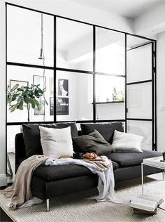 Interior steel windows as room divider