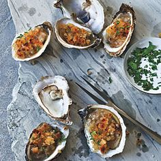 Broiled Oysters  24 oyster on the half shell 2 Tbsp lemon juice                                  3 Tbsp green onion minced 2 Tbsp Parsley minced Salt/ pepper 6 strip bacon chopped up Bread crumbs ½ cup Parmesan Cheese 2 tbsp Butter  1 tbsp Olive oil FOR MORE INFO https://www.facebook.com/WhatsForSupperWithSharonPeeleKennedy