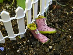 Fairy Garden Wellies    These are the cutest little wellies. Would make an adorable addition to bring a splash of color and charm to the garden. These little rain boots are a lavender color with a springy green sole and a darling little daisy in front.   I like to put these next to a fence or the door of a fairy house. Would also be cute in a wheelbarrow along with other garden gear.  **Boots measure 3/4 tall x 7/8 long x 3/8wide **Made of resin **Safe for indoors or outdoors  ...