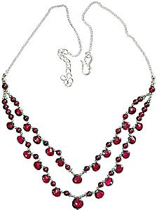 """Jewelry: Sterling silver Semi-precious gemstones: Red Garnet 2 Strand Drop Necklace adjusts from 16-18"""". Beautiful genuine garnet stones. Beads and faceted tear shaped drops, sterling silver, double strand.  LORE---Garnet said to bring: Courage, fortitude, aids in finding & walking ones true path in life, activates one's ability to connect to Angels & guides & feel divine love. Aligns body emothions & spirit for one's highest good.Garnet: powerful energizer, bringing serentiy or passion as…"""