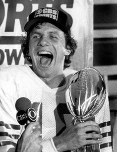 Quarterback Joe Montana #16 of the San Francisco 49ers holds the Vince Lombardi Super Bowl Trophy in the dressing room after defeating the Cincinnati Bengals in Super Bowl XVI on 24 Jan 1982