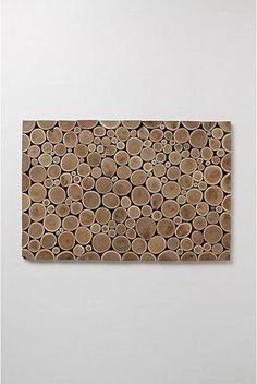 A doormat made of wood slices.