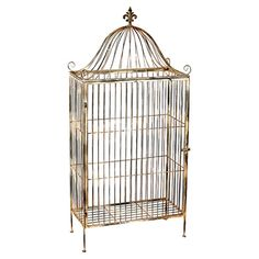 Display your favorite cookbooks in the kitchen or family photos in the den with this vintage bird cage-inspired iron display shelf, showcasing a gold finish ...