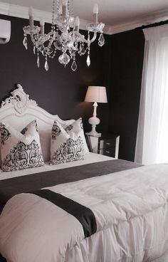 Monochrom French Main Bedroom. Dark wall, white french headboard & crystal chandelier