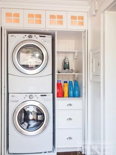 Hidden laundry closet with stackable front loading washer and dryer + storage.