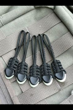 Paracord zipper pulls *lol they look like sneakers. How cool :) ... Oooh for the ends of sneaker shoe laces???
