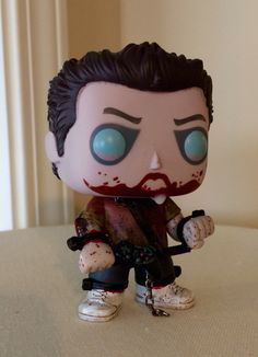 Funko Pop, Shaun of the Dead: 'Zombie' Ed.  Custom Re-Paint (Shovel removed, left hand turned over, green added to bottom of red shirt, bite/blood added to right arm, game controller added, 'drool' on mouth, shackles/bars and chains added around neck, wrists and ankles).